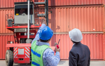 foreman control forklift handling follow order from his manager for move the container box loading